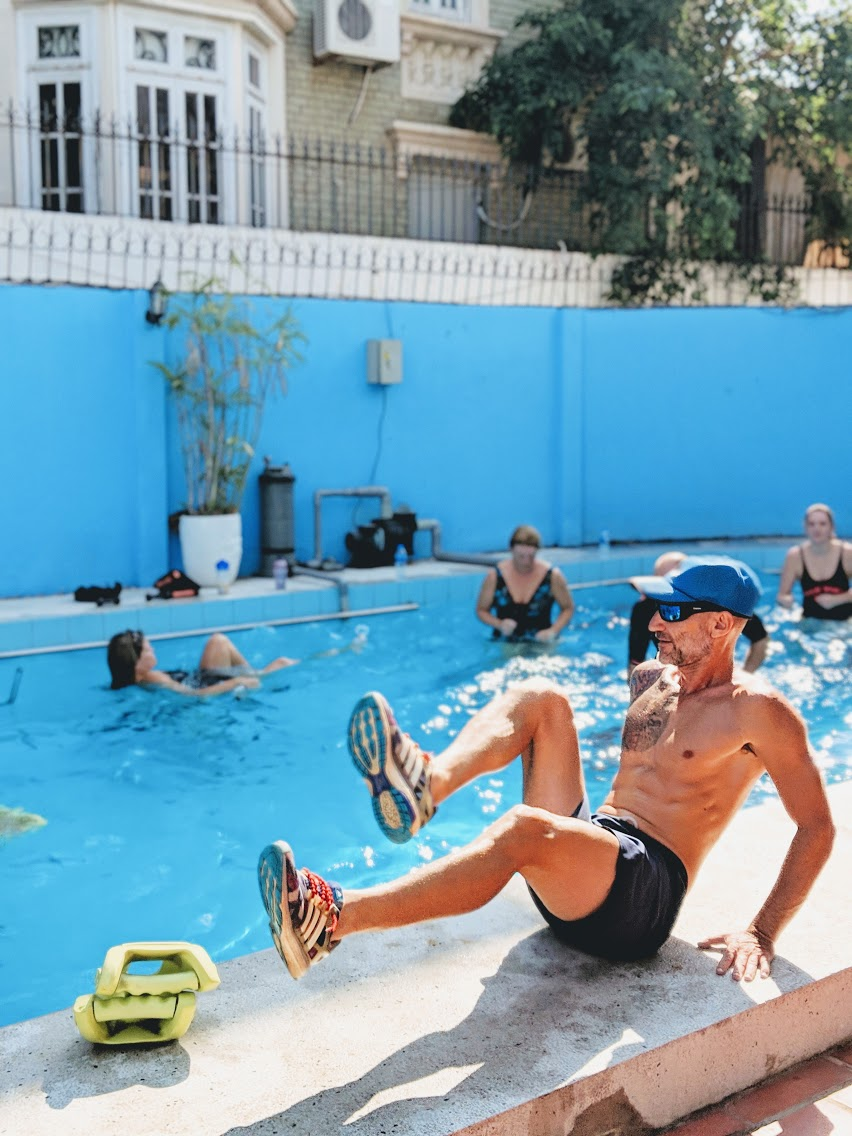 Fitness in the water coach WATERFIT+ showing exercise