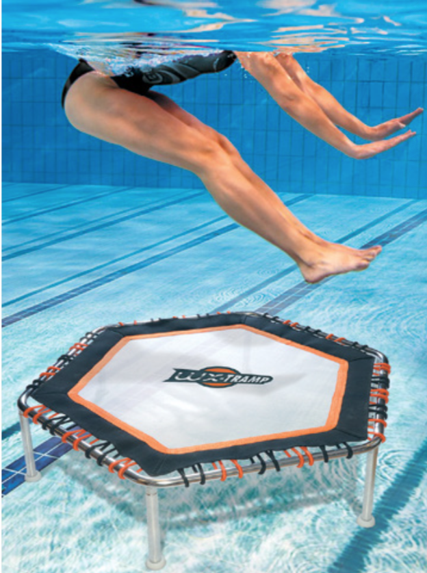 Woman jumping on a trampoline underwater at WATERFIT+